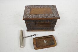 "A small Kashmiri carved walnut card box, 4½"" x 3"" x 3"", together with a carved hardwood snuff box"