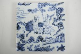"""A Chinese blue and white pottery tile decorated with two sages and a buffalo in a landscape, 8"""" x 8"""""""