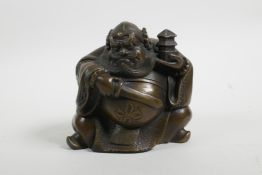 """A Chinese filled bronze of a rotund Immortal, 4½"""" high"""