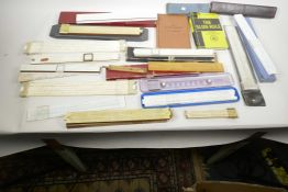 A box containing a collection of slide rules and instruction manuals