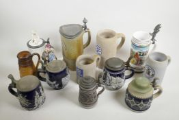 """A collection of assorted German pottery beer steins, largest 9½"""" high"""