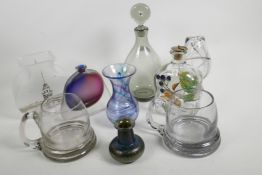 A collection of studio glass including a Holmegaard dimple decanter, a Pasabahce vase with silver ov