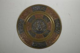 An Indian brass wall plaque with inlaid repousse copper and metal decoration of Ganesh and exotic bi