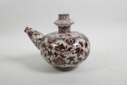 """A Chinese red and white porcelain water pourer with scrolling floral decoration, 6"""" high x 6"""" diamet"""
