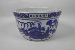 A Chinese blue and white porcelain jardiniere decorated with figures in a landscape, star cracks