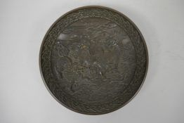 """A Chinese bronze trinket bowl with raised kylin decoration, 4 character mark to base, 7"""" diameter"""