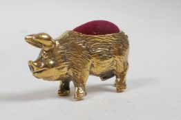"""A brass pincushion in the form of a pig, 1½"""" long"""