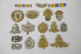 A quantity of assorted British Forces and other service badges