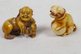 A small Japanese bone netsuke figure crouching with a flask, together with an Oriental figure of a