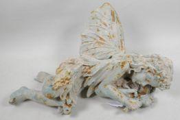 "A metal garden figure of a sleeping fairy, 17"" long"
