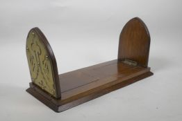 """A Gothic oak book slide with decorative brass mounts to end, 13"""" long collapsed"""