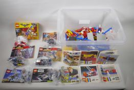 A large collection of original 'Lego System' pieces and manuals (all loose), together with a