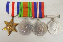 A set of three British Second World War service medals together with a WW2 campaign medal