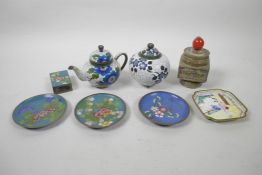 A collection of Chinese cloisonne and Canton enamel dishes, pots, teapots etc, decorated with