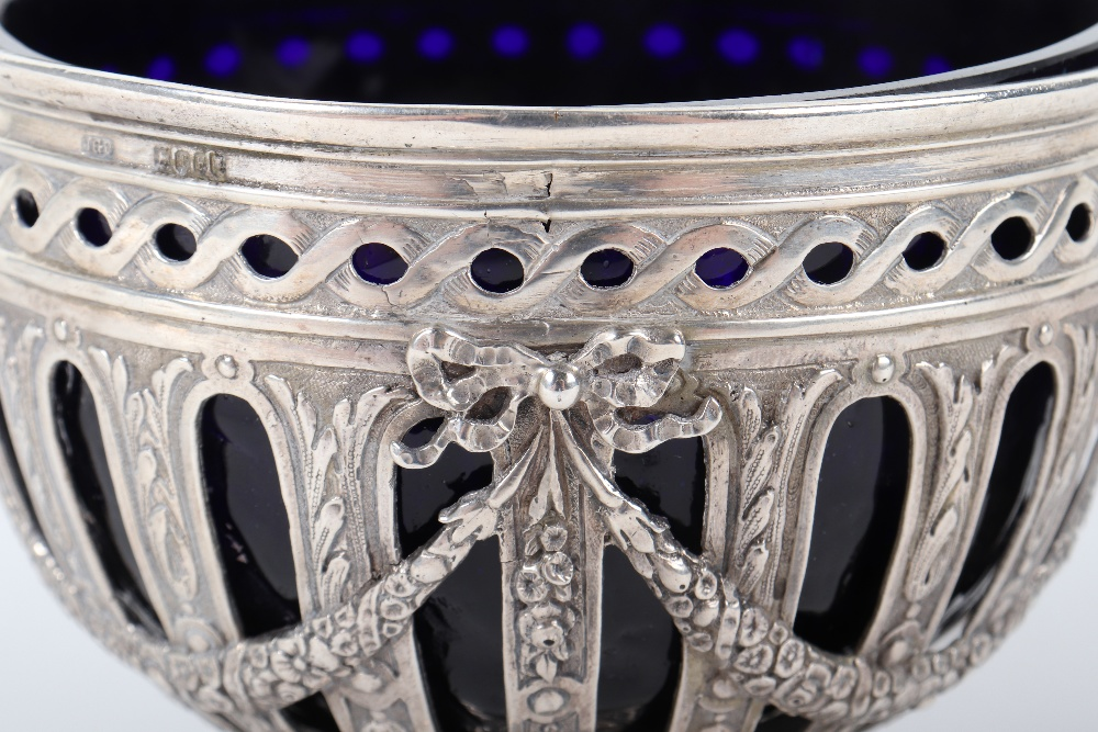 Lot 20 - An unusual early 20th century silver and glass sugar bowl marked 930 to base, London 1902, John Geor