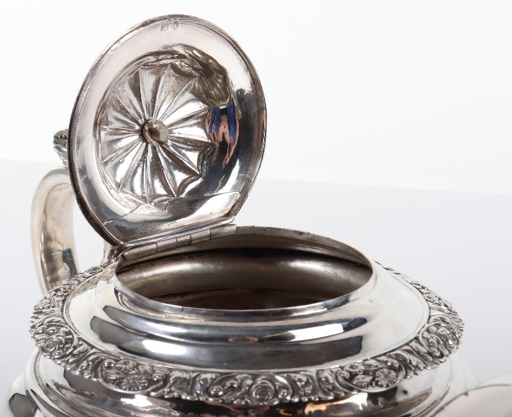 Lot 18 - A George III silver teapot, London marks