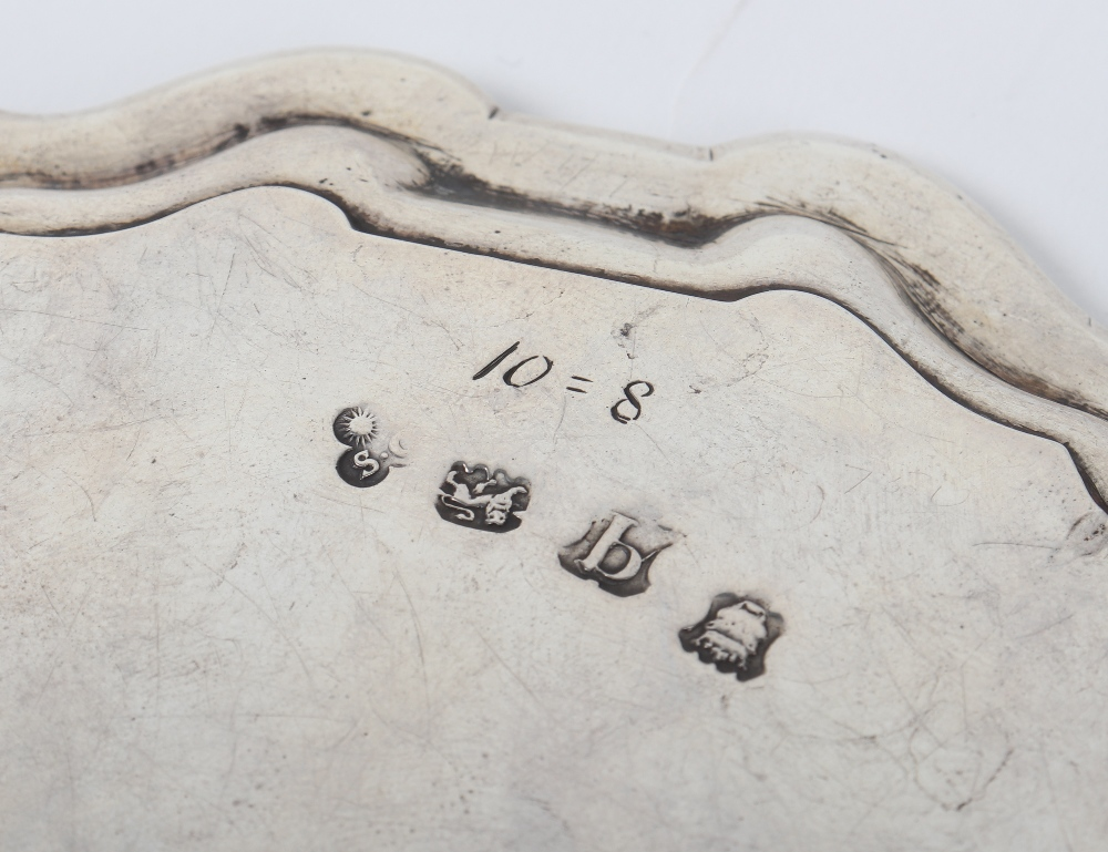 Lot 51 - A pair of George II small salvers, Samuel Courtauld, London 1751