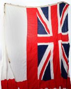Very Large Royal Navy Battleship White Ensign, multipiece construction white cotton ensign with enforced edge having rope ties and brass fittings. Stamped with details and war department arrow. Very good condition.