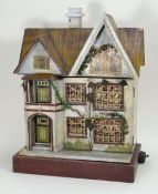 A charming wooden painted dolls house, probably D.H Wagner & Sohn, German 1920s,