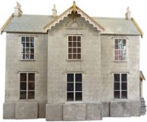 C.D.H a large and impressive painted grey stone wooden English Country Manor dolls house, 1868,