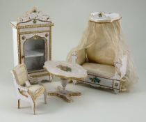 A four-piece set of decorative French miniature furniture, 1880s,