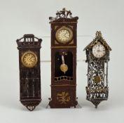 Three miniature wall-clocks for dolls house, German circa 1890,