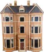 'Newick House' a painted wooden English Town dolls house, circa 1880,
