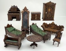 Group of miniature wooden dolls house furniture with carved decoration, German circa 1890,