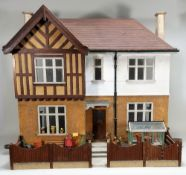 A Tudor style dolls house, English 1930s,
