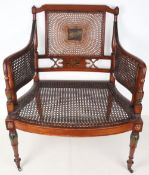 A Regency wicker armchair, painted decoration and painted back panel