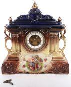 A 19th century painted ceramic cased mantle clock