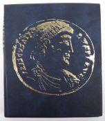 A folder of GB coins