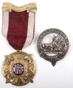 A silver gilt Masonic medal, London 1931, with a Scottish Clan brooch 'Ne Obliviscaris'