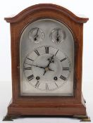 A 19th century mantle clock, silvered dial