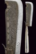 A ceremonial axe with silver hilt