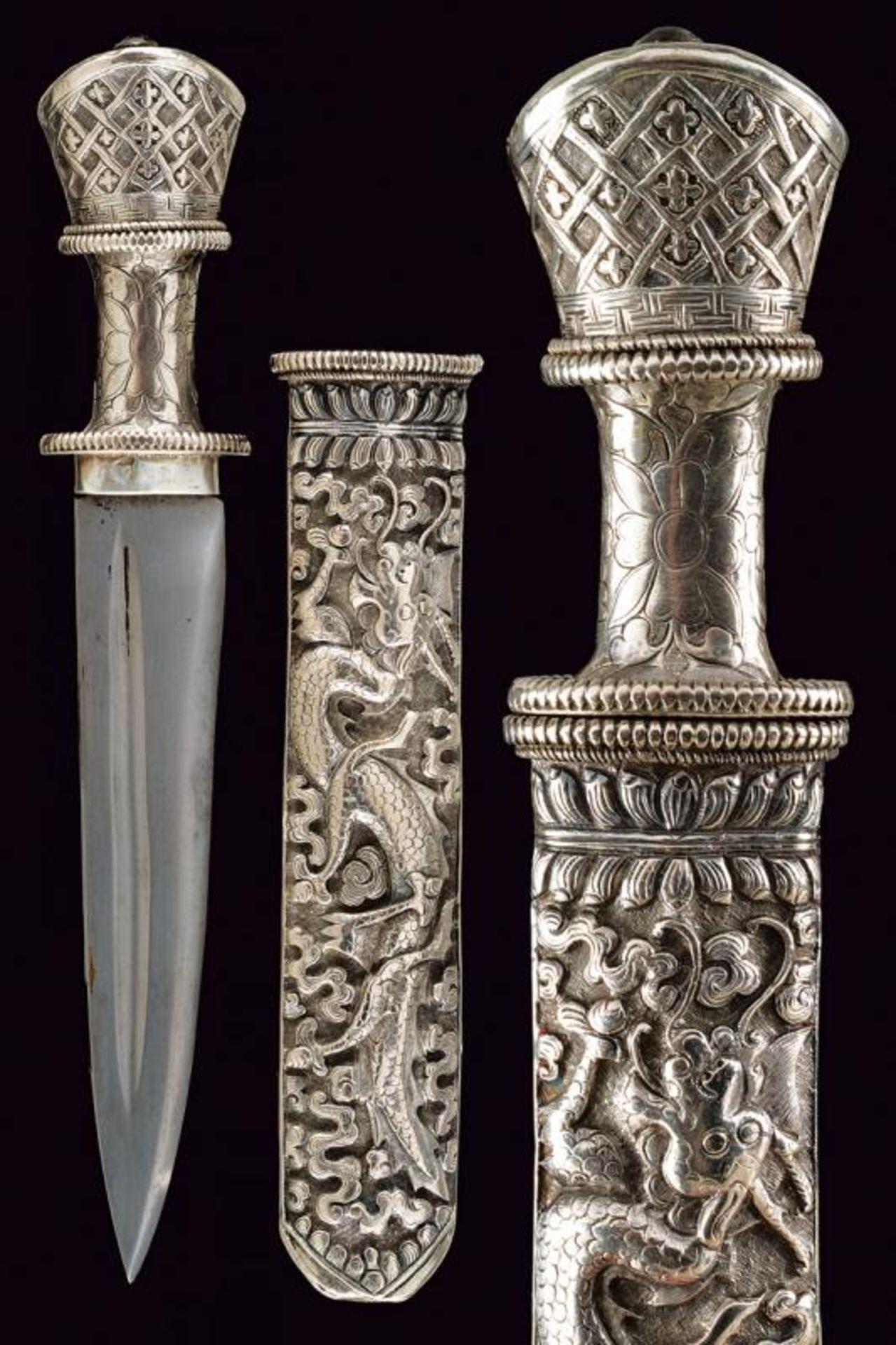 A beautiful silver mounted knife