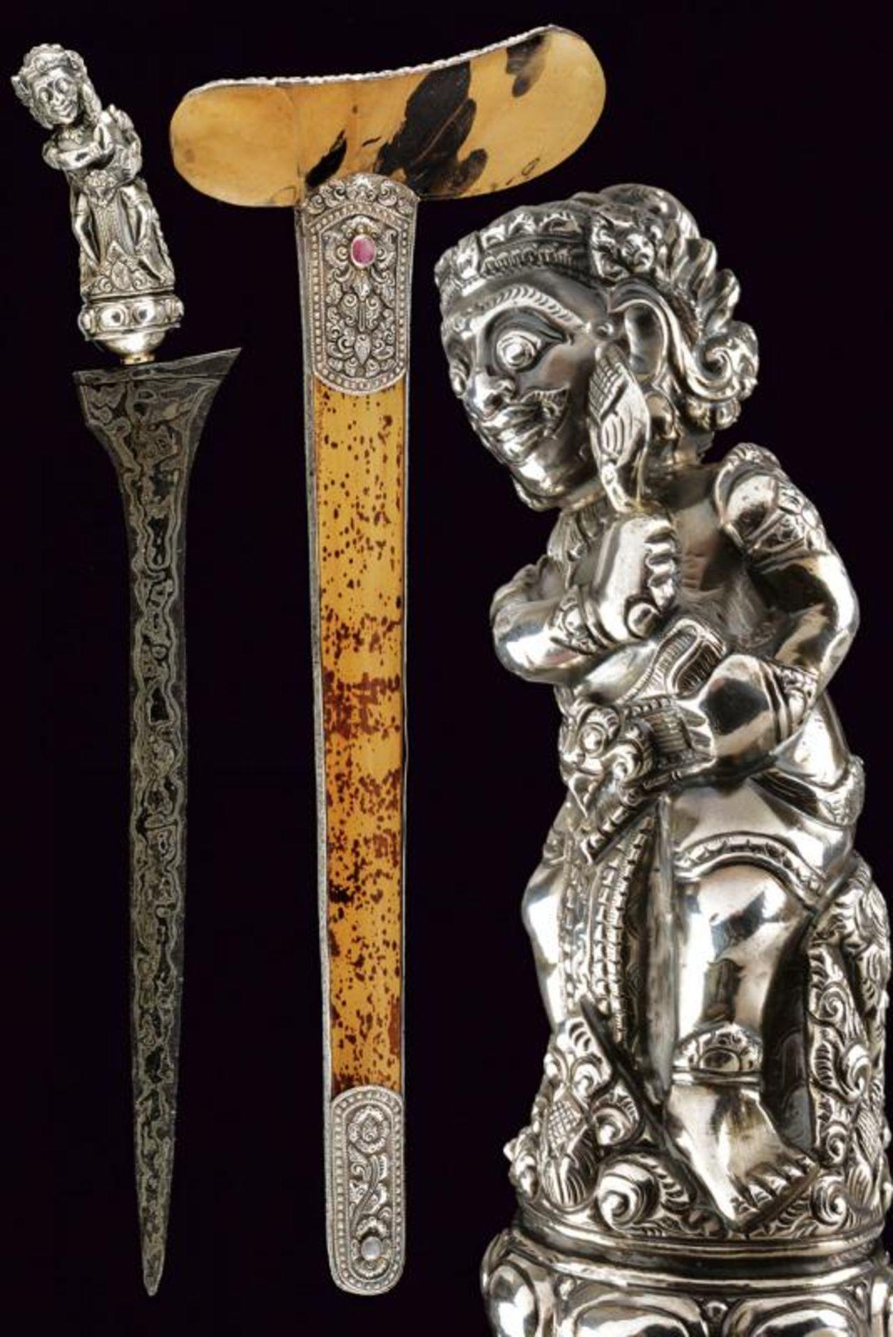 A beautiful silver mounted kris