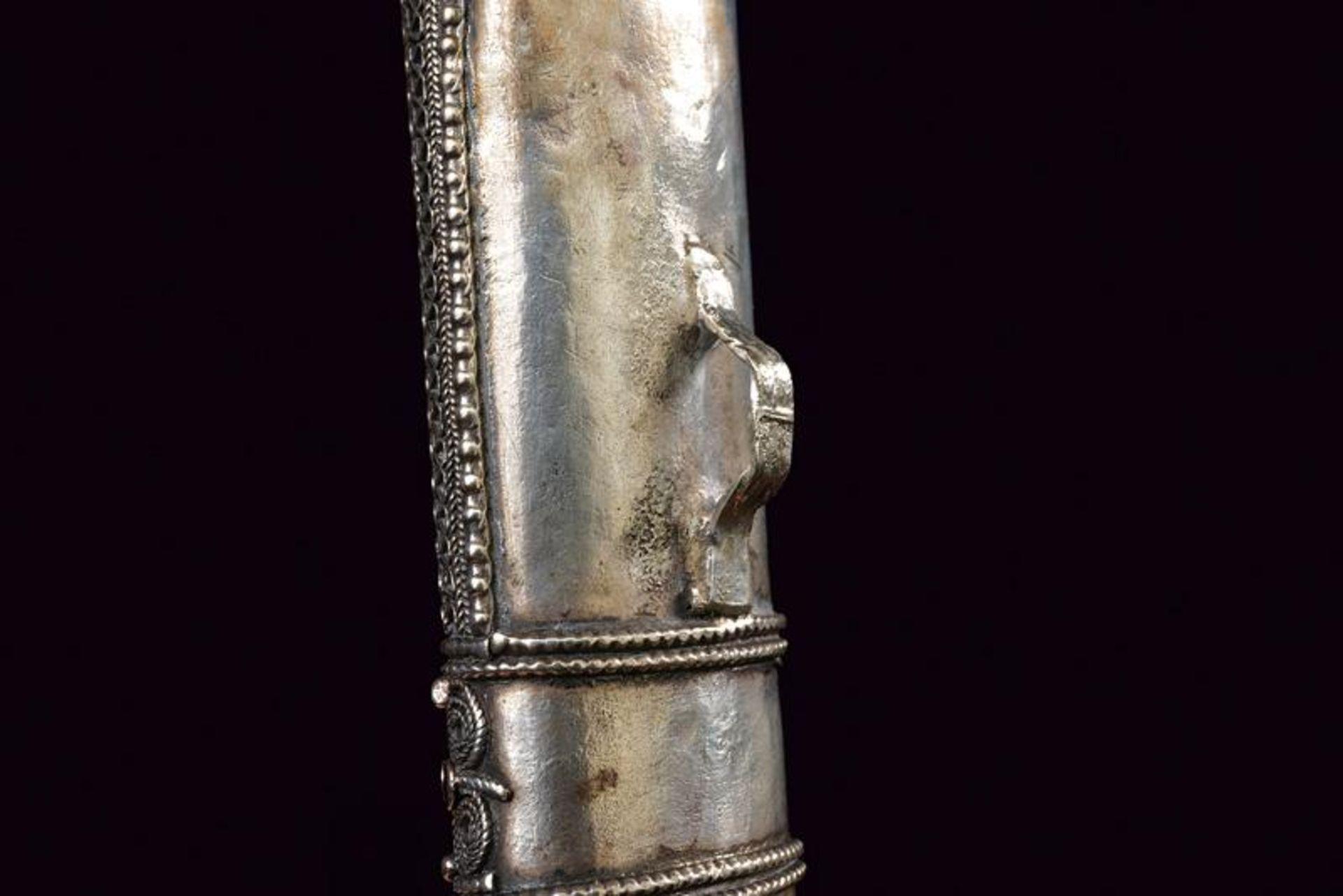 A silver scabbard