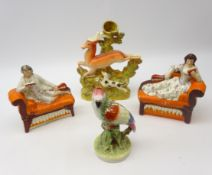 Staffordshire flatback figures of male and female musicians, lying on couches and reading music,