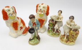 Matched pair Victorian Staffordshire figures of a girl with lambs and boy with broom and pair