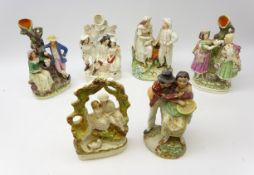 Collection of 19th century and later Staffordshire groups including three spill vases: 'The Rival'