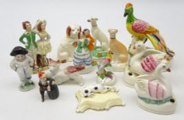 Two Victorian Staffordshire Swan moulded pen holders and another in the form of a Parrot, H14.