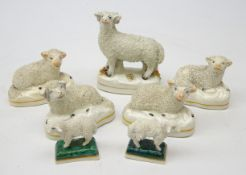 Four Victorian Staffordshire recumbent Sheep, pair miniature Sheep and another standing,