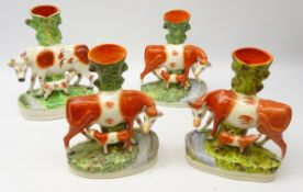 Three Staffordshire Cow and Calf spill vases and matching group,