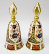 Two Royal Crown Derby Old Imari candle snuffers, bell form with flame handle no.