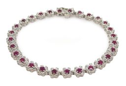 18ct white gold ruby and diamond flower cluster bracelet Condition Report Approx 7.