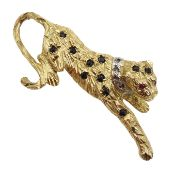 9ct gold leopard brooch set with sapphires and rubies and diamonds,