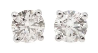 Pair of 18ct white gold diamond stud earrings, stamped 750, diamond total weight 1.