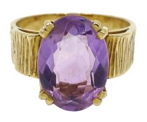 Gold oval single stone amethyst ring, bark effect shank,