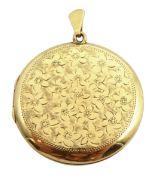 9ct gold circular locket, with engraved decoration hallmarked,